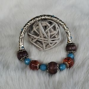 ✅🔛Silver toned and wood beaded stretch bracelet